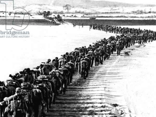 334th Regiment, 119th Division, of Fifteenth Chinese Field Army crosses the Yalu (Yalujiang) River in Andong