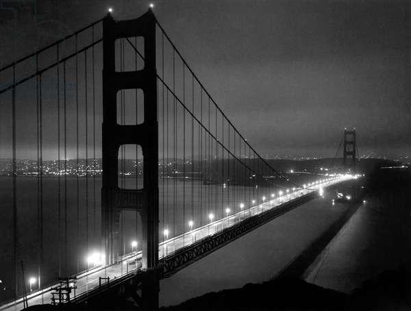 Golden Gate Bridge At Night, San Francisco, California, May 25, 1937 (b/w photo)