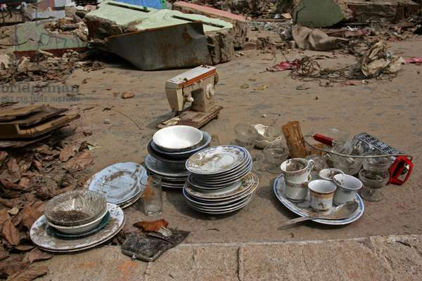 4th January 2005: Even within this rubble there was unbroken crockery and other items that families were able to collect in the ruins of their homes. Sri Lanka Tsunami.  (photo)