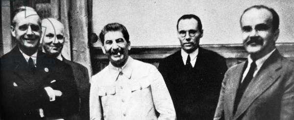 Joachim von Ribbentrop, Joseph Stalin, and Vyacheslav Molotov