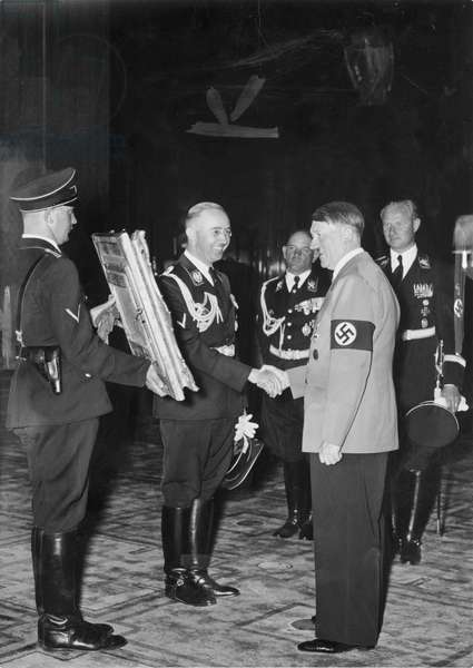 Adolf Hitler presented with a painting from SS Chief Heinrich Himmler, circa 1937.