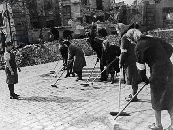 German Women Sweeping a Berlin (?) Street after the German Surrender at the End of World War 2 in 1945, They are Being Supervised by Marusia Kuznetsova, a Russian Girl Who Spend More Than 2 Years as a Slave Laborer.