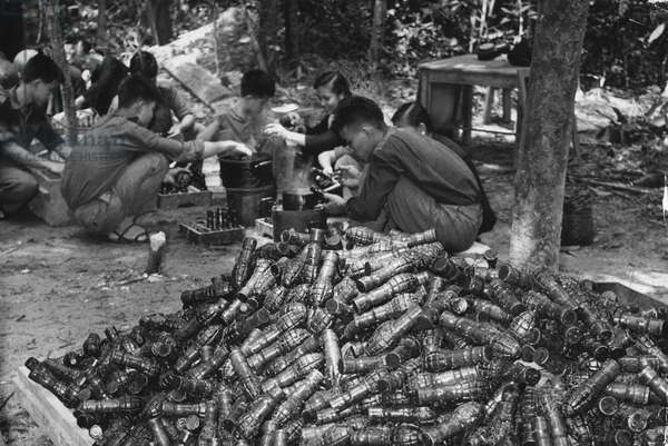 Communist guerrillas make grenades for National Liberation Army troops fighting the US South Vietnam, Vietnam War, 1965