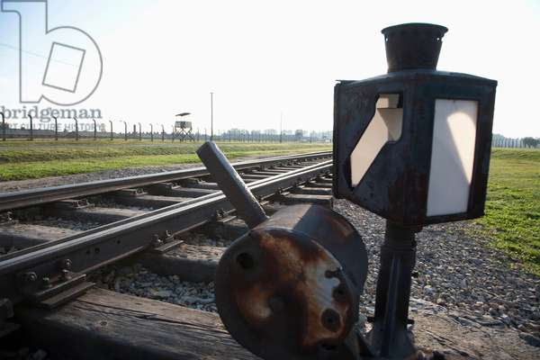 Switch on the Railway Track Along the 'selektionsrampe', the Platform Where People Where Selected to Die in the Gas Chambers Immediately Or to Work to Death at the Auschwitz-Birkenau Concentration Camp, Oswiecim, Malopolska, Poland (photo)