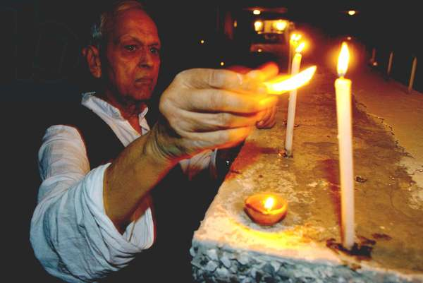 An Indian man lights candles to celebrate the first day of Diwali or Festival of Lights despite the serial blasts three days ago in New Delhi, capital of India, Nov 1, 2005