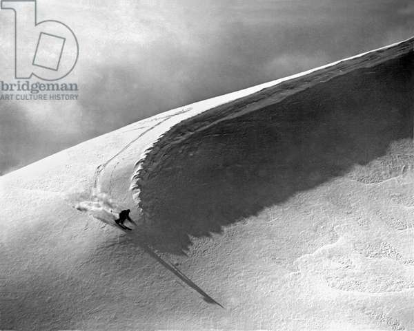 Skiing Under A Curl (b/w photo)