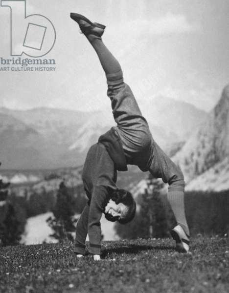 Acrobatic Woman, Bow Valley, Alberta, Canada, August 9, 1923 (b/w photo)