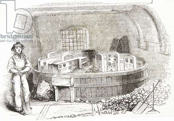 Grinding calcined and crushed flint placed in a tank of water and ground until the consistency of cream ready for use in pottery manufacture, Staffordshire, England. Engraving, 1843.