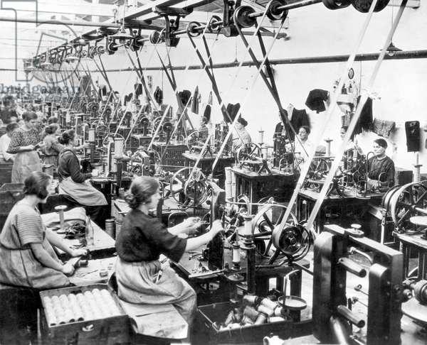 Women sewing in garment factory (b/w photo)