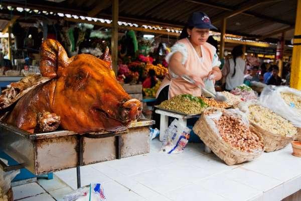 Pig's Head in An Eatery at the Saturday Market, Otavalo, Imbabura, Ecuador (photo)