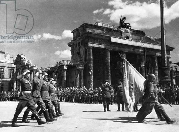 Soviet Red Army Troops During a Victory Parade in Front of the Brandenburg Gate in Berlin, Germany at the End of World War 2, May 20, 1945.
