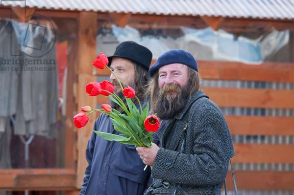 Man With Flowers in Trakai, Lithuania (photo)