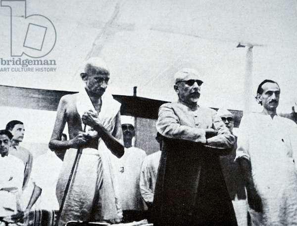 Mohandas Karamchand Gandhi at a meeting with Maulana Azad and Jivatram Kripalani, 1946
