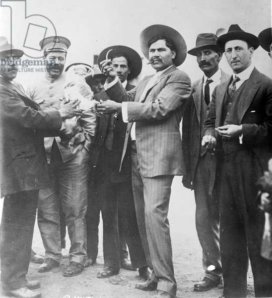 Francisco Pancho Villa, born Doroteo Arango Arambula (1878-1923), Mexican Revolutionary General. Villa, second left in military cap, with Raul Madero, c1923, Villa was ambushed and assassinated on 20 July 1923.