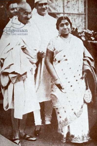 Mahatma Gandhi With Mahadev Desai and Sarojini Naidu on their way to Buckingham Palace.
