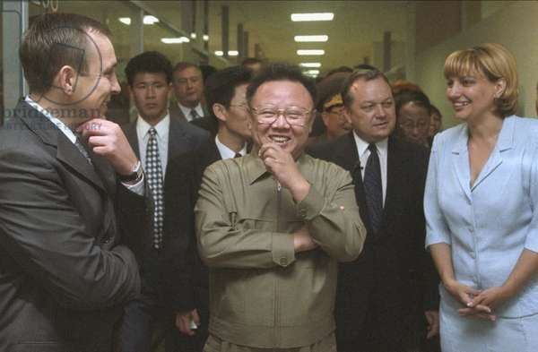 Visiting North Korean Leader Kim Jong-Il (C) Touring the Trade Complex 'Ignat' Accompanied by Its Executive Director Yelena Kalinina (R) and Vice-Governor of Russia'S Maritime Territory Igor Ivanov (L) in Vladivostok on Friday.