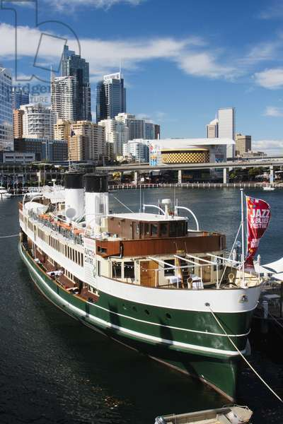 Australia, New South Wales, Sydney, National Maritime Museum in old fashioned ferry moored in Darling Harbour with skyscrapers in background