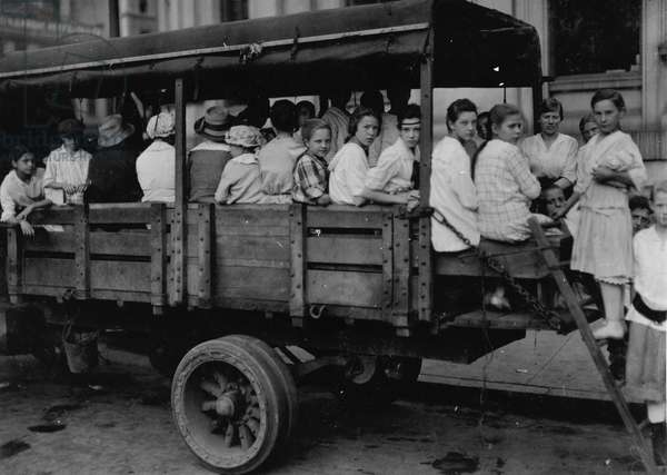 6:00 A.M. at Post Office Square. Truck load of tobacco workers bound for American Sumatra Tobacco Farm, 1917 (photo)
