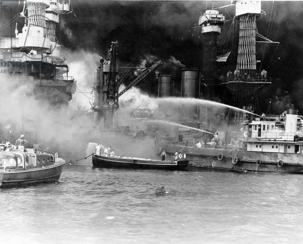World War II: Japanese attack on United States naval base at Pearl Harbour, Hawaii, 7 December 1941. Battleship USS West Virginia in, flames after hits from Japanese bombs and torpedoes.