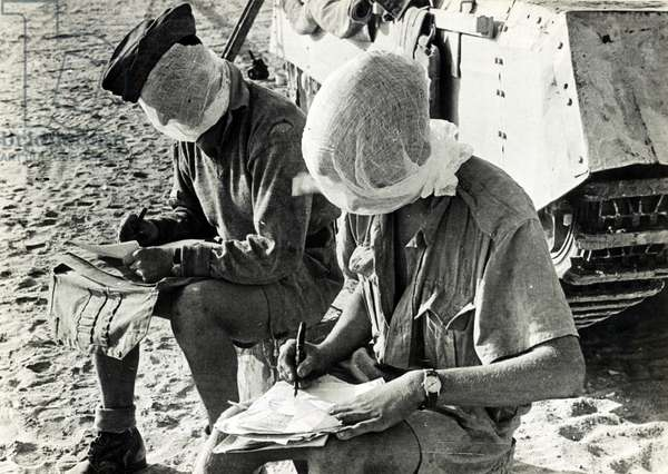 British World War Two soldiers with their heads covered.