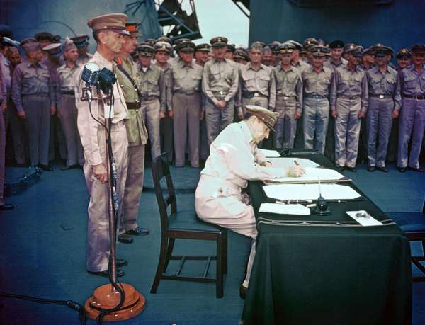 General Douglas MacArthur signing The Japanese Instrument of Surrender on behalf of the Allied Powers, September 2, 1945