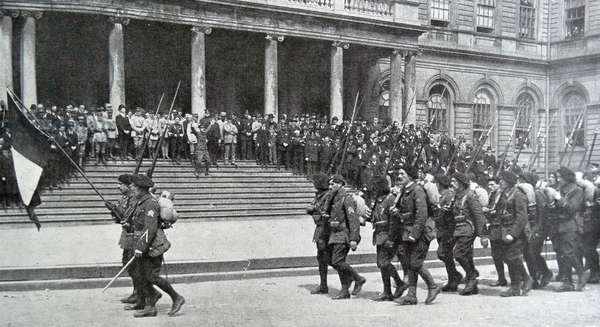 French soldiers parade past the Mayors office in New York City, 1918
