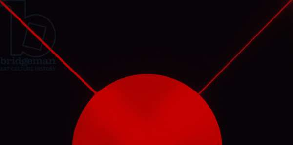 Red laser beam on black background.