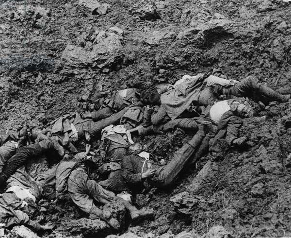 Somme German dead in shell hole, 1916 (b/w photo)