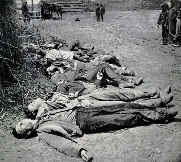 Dead Confederate soldiers ot General Ewell's Corps who attacked the Union lines at the Battle of Spotsylvania, 19th May, 1864 (b/w photo)