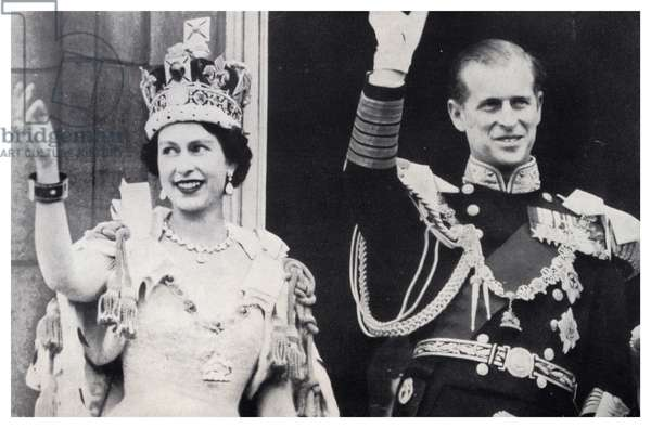 Queen Elizabeth II and Prince Phillip wave from Buckingham Palace