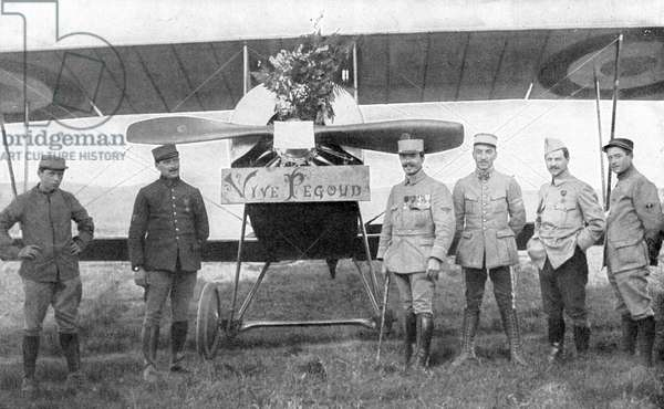 French Air ace Adolphe Pegoud, 4th from right, in front of his plane on the day when fellow officers presented him with a bouquet in celebration of his latest citation. Killed action 1915. First World War