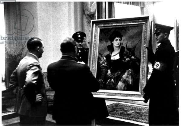 Adolf Hitler presenting Nazi Party senior figure, Hermann Goering a painting.
