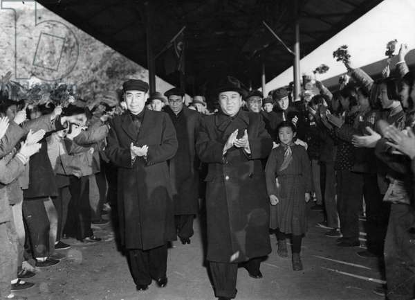 Korean War. The Korean Government Delegation headed by Marshal Kim Il Sung (right) being greeted at the railway station in Peking by Chou En-lai (left) during their visit on November 12, 1953