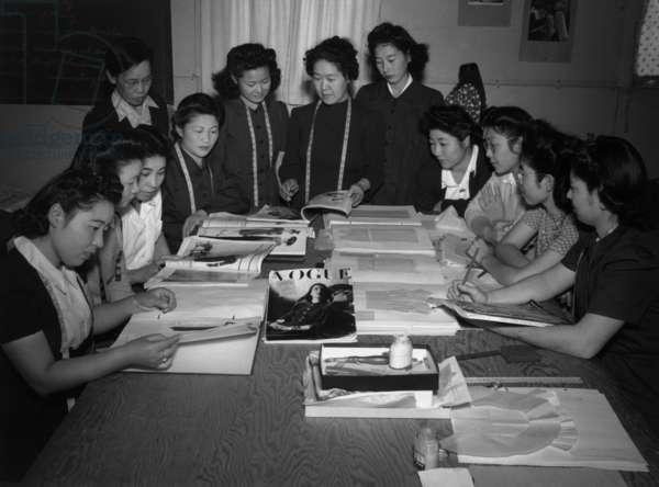 Mrs. Ryie Yoshizawa, teacher of fashion and design, Manzanar Japanese American Internment Camp, California, 1943 (b/w photo)