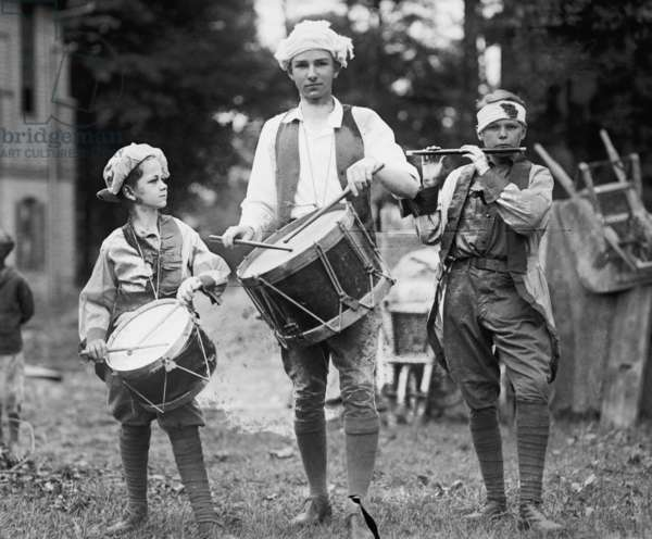 Three Boys March with Instruments on the 4th of July Celebration 1922 (photo)