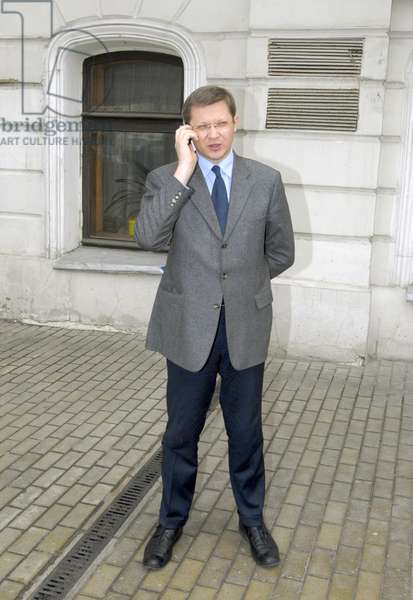 State Duma Deputy Vladimir Ryzhkov Talks on his Mobile Phone Before the Other Russia Organization'S Forum in the Central House of Journalists, Moscow, April 19, 2007, Moscow, Russia.