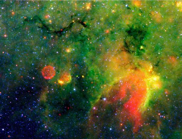 Spitzer Space Telescope infrared image of a snake (upper left) and surrounding stormy environment. It is actually the core of a thick, sooty cloud large enough to swallow dozens of solar systems. Credit NASA.