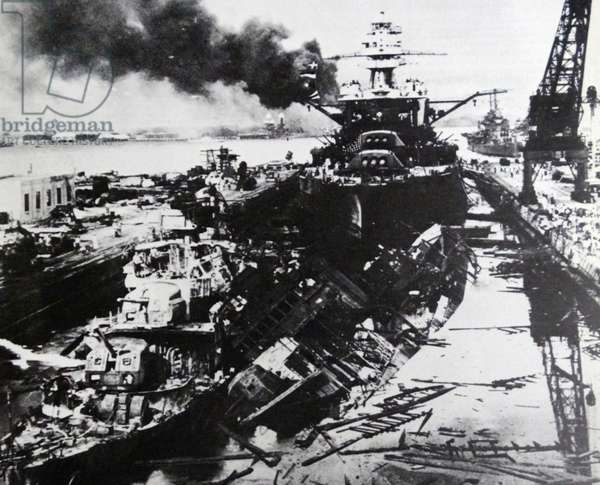 USS Pennsylvania, behind the wreckage of the USS Downes and USS Cassin after the attack on Pearl Harbour