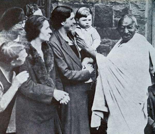 Mahatma Gandhi visits Lancashire's cotton mills.