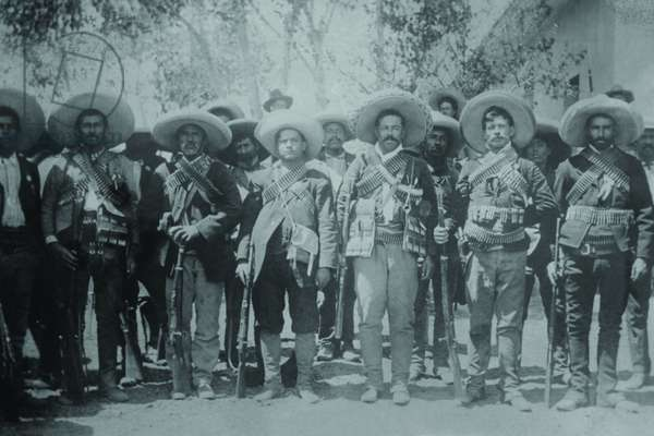 Pancho Villa and His bandits with bandoliers and guns 1919 (photo)
