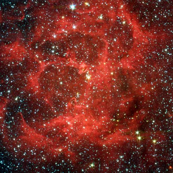 Spitzer Space Telescope comparison views in visible light and infrared of the glowing Trifid Nebula, a giant star-forming cloud of gas and dust located 5,400 light-years away in the Sagittarius. Credit NASA. Science Astronomy