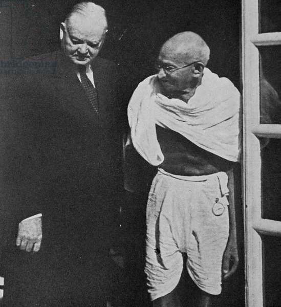 Gandhi meets visiting Ex-President Herbert Hoover of the USA