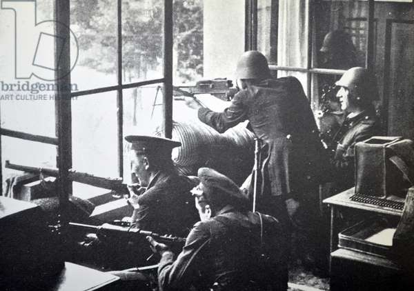 Republican soldiers fire from a building during the Spanish civil war, Barcelona 1937