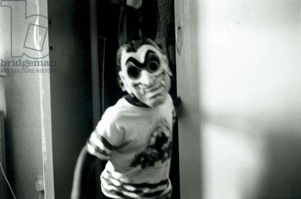 Boy wearing a scary mask Luton UK 1992.