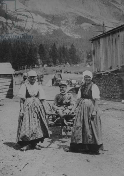 Italian women of Cortina taking a convalesent wounded Officer for an airing in a small farm waggon, 1916 (b/w photo)