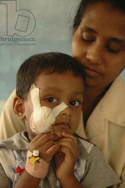 After tsunami, a child with her mother receives treatment for injuries in Matara General Hospital. Southern Sri Lanka.  (photo)