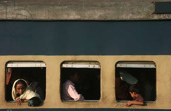 Homebound people crowd in a train at the Chittagong railway station on the eve of Eid-ul-azha, one of the two largest festivals of the Muslim community, the other being Eid-ul-fitr. Chittagong, Bangladesh. November 25, 2009.  (photo)