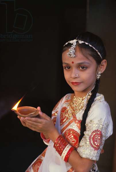 India,  Diwali (Deepavali) Festival (Oct/Nov).  Young Girl With Oil Lamp