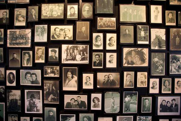 Installation at the Sauna Displaying Photographs Found Among the Belongings of People Murdered at the Auschwitz-Birkenau Concentration Camp, Oswiecim, Malopolska, Poland (photo)