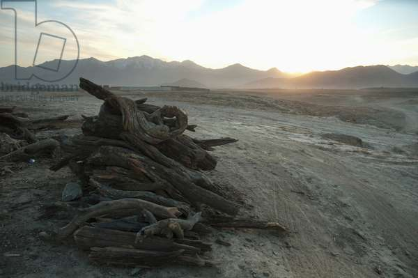 Wood and Used Tire Vendor in Maidan Shar at Sunset, Vardak Province, Afghanistan (photo)